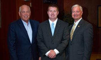 Jeff Fettig, David Reimers, and Randy Reimers